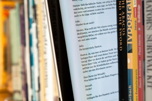 EBook between paper books ALA Midwinter 2012: ALA To Meet With Top Executives of Macmillan, Simon & Schuster, and Penguin on Ebook Lending