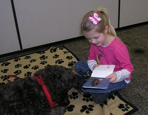 Jayne Lunsford age 5 Therapy Dogs Presence Steadily Grows in Libraries