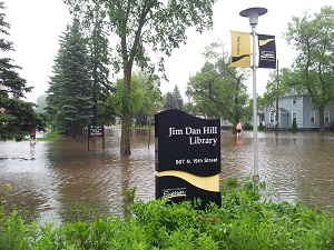 Library sign surrounded by floodwaters