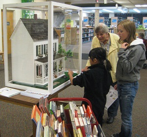 Patrons visit the Storybook Dollhouse in Dayton Building A Storybook House