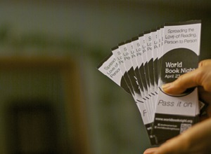 Hands giving out World Book Night flyers