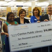 Eva Davis (Canton PL Director) and Board of Trustees with the big check