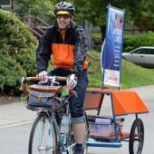 Books on Bikes Librarian Jonathan Koroschec arriving at TOPS