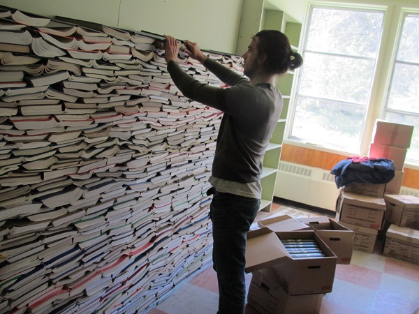 building book wall Nova Scotia Sustainability Center Gives New Life to Library Discards