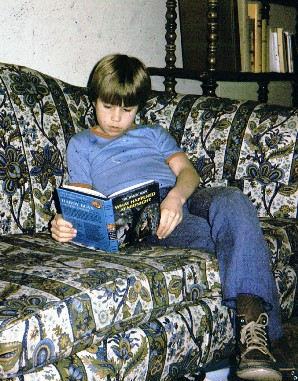 Rick Anderson as a child, with book