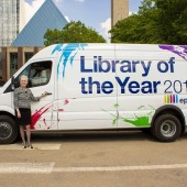 Edmonton Public Library CEO Linda Cook shows off the new paint job for the library's epl2Go Literacy Van.