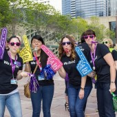 Edmonton Library staffers celebrate the LOTY honor with foam fingers and party favors.