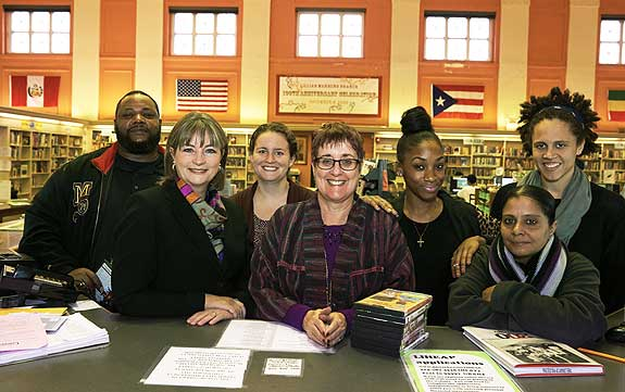 BY LEAPS AND BOUNDS At the Lillian Marrero Branch, part of the North Philadelphia cluster, Reardon chats with students participating in LEAP, the Literacy Enrichment After-school Program. Photo ©2015 Jon Roemer