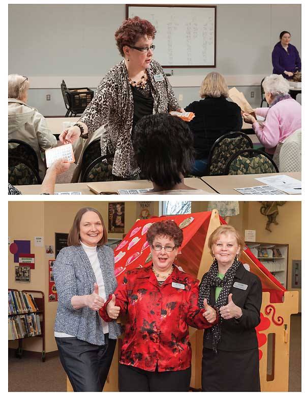BINGO! From on-site senior programming such as running a bingo game (c.) to making at-home visits, Kraus does it all. Above, she displays her enthusiasm with fellow staffers (l.–r.) head of youth services Lisa Neal and HPL director Louise Humphrey. Photos by Mitchell Kearney