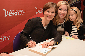 GRAND PRIZE Peggy V. Helmerich Distinguished Author Award winner Ann Patchett (signing) at Tulsa City-County Library. Photo by John Fancher