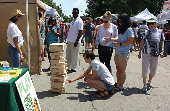 GIANT JENGA Chicago Public Library engages new audiences at the Square Roots Festival as part of the Games on the Go program, created trough design-thinking methods. Photo by Mariella Colon