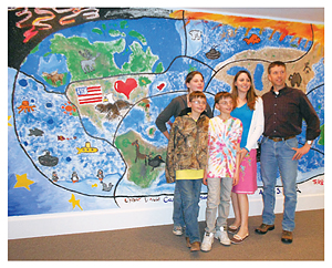 A family at the Operation Military Kids mural unveiling during the Speak Out With Art Program at the Belgrade, MT, Community Library