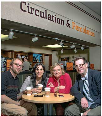 HIGH ENERGY Corinne Hill hits the library's coffee shop with staffers (l.–r.) Justin Hoenke, Alei Burns, and Nate Hill (as always, no relation). Photo ©2014 Dan Reynolds Photography