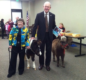 Director Dolores Greenwald and Ken Moore, Mayor of Franklin, with mini horses Bucky and Bonnie