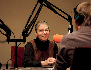 A NATIONAL VOICE: With radio mic still poised, Pearl chats with Jim Gates, a senior producer at KUOW, the NPR affiliate in Seattle, just after her Weekday show, hosted by Steve Scher. Photo by Ron Wurzer/Getty Images