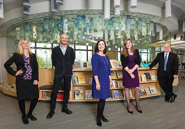 TEAMING UP Director Davies and a few of her key leadership staff (l.–r.): Linda Speas, director of library services;  Oliver Sanidas, director of digital and material services (a 2015 LJ Mover & Shaker); Davies; Jessica Sidener,  director of communications, programming, and partnerships; and Ted Fleagle, director of administrative services.  Photo by Paul Wedlake Photography, wedlakephoto.com