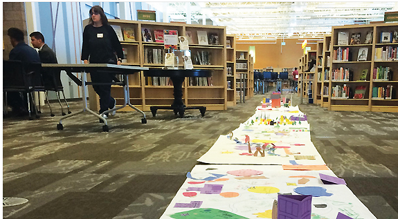 """WEARING """"ANYTHINK GOGGLES"""" Dream neighborhoods created by Anythinkers during their November 2015 training day on display in Anythink Wright Farms. Photo by Anything Libraries"""