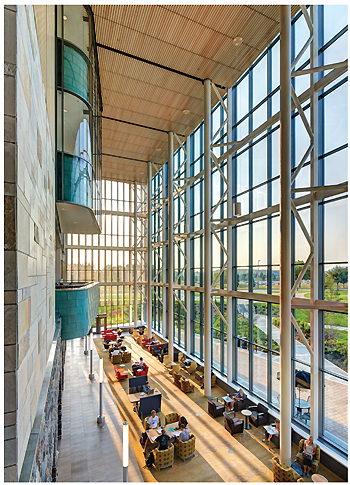 The vaulted grand atrium with campus views. Photo By James Haefner Photography/Stantec Architecture