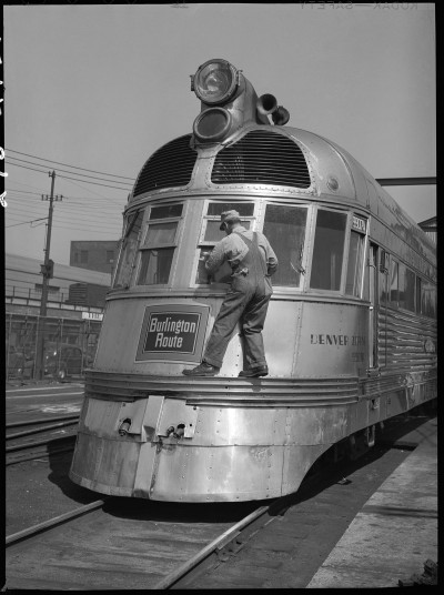 """Workers cleaning diesel car, 14th Street passenger yards, Chicago, May 1948"" Chicago, Burlington & Quincy Railroad Company Archives Newberry Library"