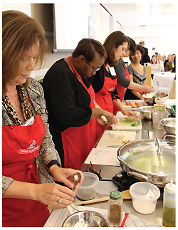 Volunteers contribute to a demonstration of FLP's Culinary Literacy program