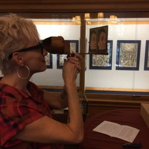 female professor looking through stereoscope